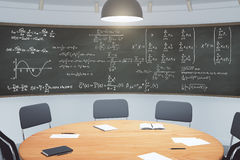 Modern classroom with furniture and blackboard with equations Royalty Free Stock Image