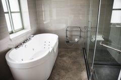 Modern, clean, bathroom with bathtub and shower.