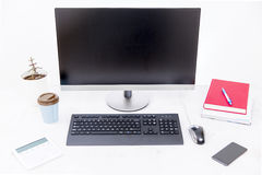 Modern, clean, bright and comfortable workplace with computer, house plant and books royalty free stock photography