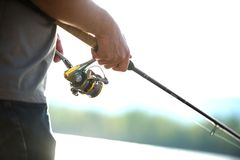 Modern clean fishing rod in hands Stock Photos