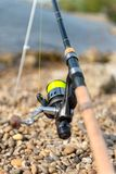 Modern clean fishing rod outdoors Royalty Free Stock Image