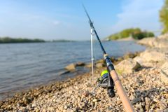 Modern clean fishing rod outdoors Stock Image