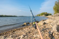 Modern clean fishing rod outdoors. On the ground Stock Photography