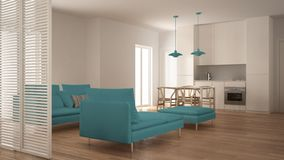Modern clean living room with kitchen and dining table, sofa, pouf and chaise longue, minimal white and blue interior. Design royalty free stock photo