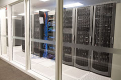 Modern clean office server room. Looking through secure glass into server area of company Stock Photos