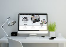 modern clean workspace with we design website on screen royalty free stock images