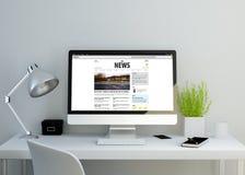 Modern clean workspace showing online news website Stock Photos