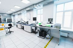 Modern clinical laboratory, white interior. Saint-Petersburg, Russia - April 6, 2018: Modern clinical laboratory interior with blood analyzer equipment stock photography