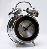 Modern and design alarm clock. It is big, elegant and bright stylish alarm clock executed in style of modern classics, the basic materials - glass and metal. Its Royalty Free Stock Images