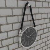 Modern clock. On brick wall Stock Photo