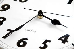 Modern clock, detail. 3:35 am/pm on modern, black & white clock Royalty Free Stock Photos