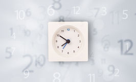 Modern clock with numbers comming out Royalty Free Stock Image