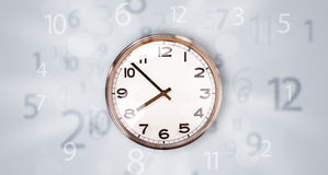 Modern clock with numbers comming out Royalty Free Stock Photos