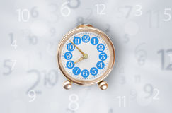 Modern clock with numbers comming out Stock Photo