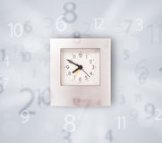 Modern clock with numbers comming out Stock Image