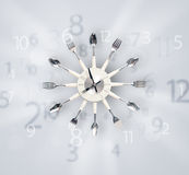 Modern clock with numbers comming out Stock Images