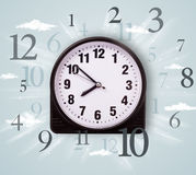 Modern clock with numbers on the side Stock Image