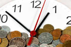 Modern Clock with Old Coins Royalty Free Stock Images