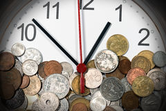 Modern Clock with Old Coins Stock Photography