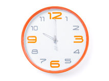Modern clock. Modern orange clock set to 10:00 Stock Image