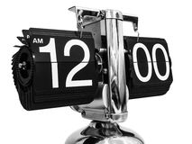 Modern clock at twelve hours zero minutes. Royalty Free Stock Photo