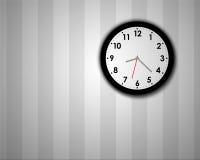 Modern clock on wall. Modern clock on a grey striped wall Stock Photo