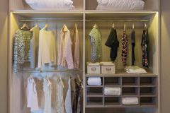 modern closet with clothes hanging stock photo