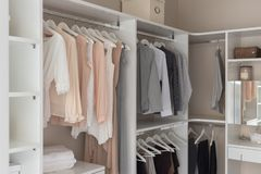 modern closet with clothes stock photography