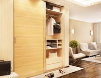 Modern closet in the hallway and view of the living room. Modern closet in the hallway and view of the modern living room stock image