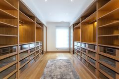 Modern closet in the hotel for different needs and clothes. Modern closet in the hotel for different needs and clothes stock image