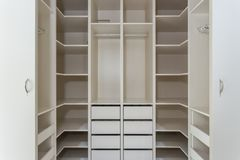 Modern closet in the hotel for different needs and clothes. Modern closet in the hotel for different needs and clothes stock images