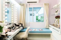 Modern closet room with make-up vanity table, mirror and cosmetics product in flat style house. royalty free stock photos