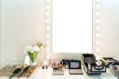 Modern closet room with make-up vanity table, mirror and cosmeti. Cs product in flat style house Royalty Free Stock Photography