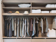 Modern closet with row of dress in wardrobe stock image