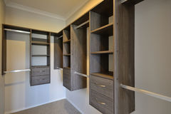 Modern closet. A modern walk-in closet with draws, hanging and shelf space Stock Image