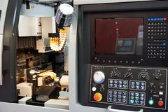 CNC Lathe. Modern CNC Lathe with control panel royalty free stock photos