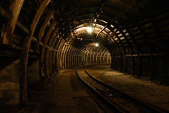 Modern coal mine. Passageway in modern coal mine with tracks stock photos