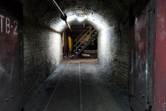 Modern coal mine. Tunnel in modern coal mine, with large steel doors, tracks on the ground stock image
