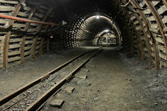 Modern coal mine. Passageway in modern coal mine with tracks stock photo