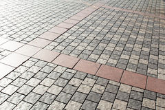 Modern cobblestone pavement useful as abstract background. Royalty Free Stock Photography