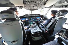 Modern cockpit of Qatar Airways Boeing 787-8 Dreamliner at Singapore Airshow Stock Photos