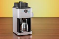 Modern coffeemaker or coffee machine on the wooden table. 3D ren. Modern coffeemaker or coffee machine on the wooden table Stock Image