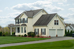 Modern Colonial House. A modern colonial style residential suburban home with a small porch and a two car garage Stock Images