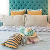 Modern colorful bedroom design with sunglass, hat, coffee cup. On tray stock photography