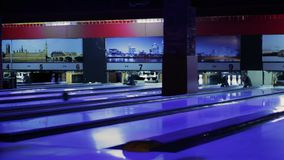 Modern Colorful bowling alley. Group game. Bowling strike competition stock video