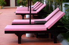 Modern colorful daybed at swimming pool Royalty Free Stock Images