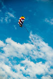 Modern and colorful kite flying in blue sky Royalty Free Stock Photos
