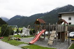Modern colorful playground on yard of Pfunds village. Modern colorful playground on yard in public garden park at outdoor of Pfunds village in evening time in Royalty Free Stock Image