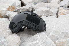 Modern combat helmet on ground. Royalty Free Stock Photos