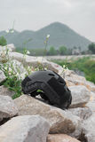 Modern combat helmet on ground. Stock Photos